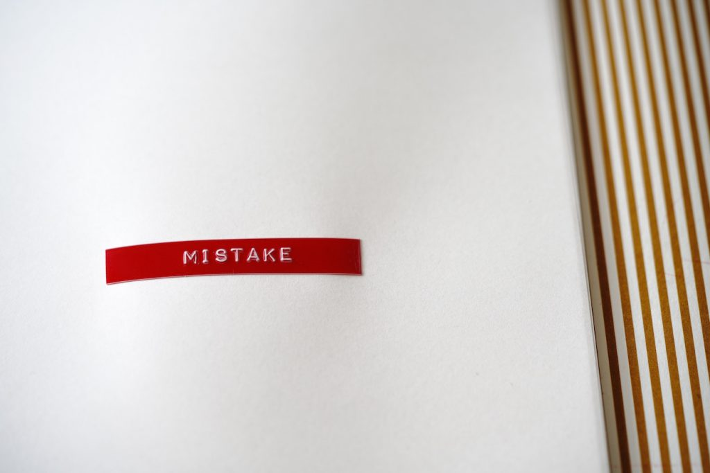 "Word ""mistake"" in red on white background"
